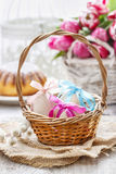 Easter eggs in wicker basket Stock Images