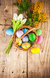 Easter eggs in wicker basket with copyspace Stock Images