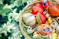Easter eggs in wicker basket Royalty Free Stock Photos