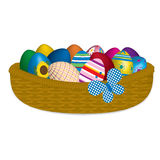Easter eggs in a wicker basket. Dyed Easter eggs in a wicker basket with a butterfly Royalty Free Stock Photos