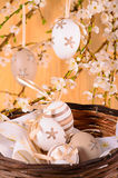 Easter eggs in the wicker basket Stock Photography