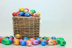 Easter eggs in a wicker basket Royalty Free Stock Images