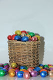 Easter eggs in a wicker basket Stock Photography