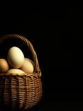 Easter eggs in a wicker basket. Stock Image