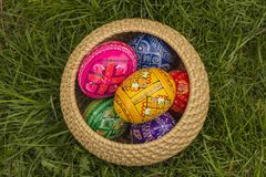 Easter Eggs. In Wicker Basket in grass royalty free stock photography