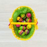 Easter eggs in a wicker basket. Greeting card Stock Images