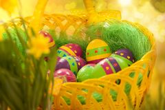 Easter eggs in a wicker basket. Greeting card Stock Image