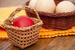 Easter eggs in wicker basket Royalty Free Stock Photography