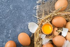 Easter eggs  in a Wicker basket with straw Stock Photos