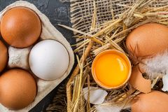 Easter eggs  in a Wicker basket with straw. Royalty Free Stock Photography