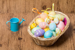 Easter eggs in  wicker basket Royalty Free Stock Images