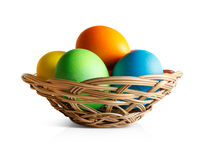 Easter eggs in a wicker basket Stock Photo