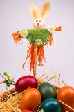 Easter eggs in wicker basket on white Royalty Free Stock Images