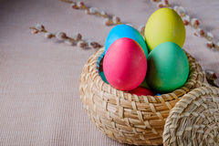 Easter Eggs in a wicker basket Stock Photos