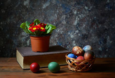 Easter eggs in wicker baskets and flowers Royalty Free Stock Images