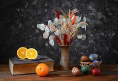 Easter eggs in wicker baskets and flowers Stock Images
