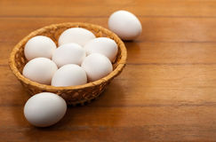 Eggs in a wicker bowl Royalty Free Stock Images