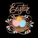 Easter eggs in a wicker nest. Luxury lettering Happy Easter Hand drawn calligraphy on a blacke background. Element for design. Great for greeting card, poster Stock Photo