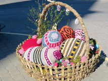 Easter eggs in wicker Stock Images