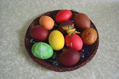 Easter eggs on wicker tray Royalty Free Stock Image