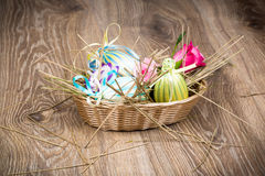 Easter eggs in the wicker Stock Photography