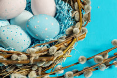 Easter eggs  and willow branches. Royalty Free Stock Photos