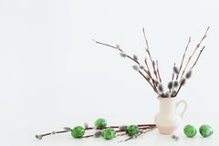 Easter eggs and willow branches on white background Royalty Free Stock Photo