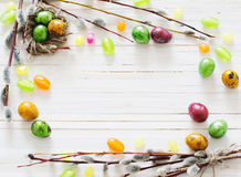Easter eggs and willow branches on white background Stock Image