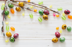 Easter eggs and willow branches on  white background Stock Photos