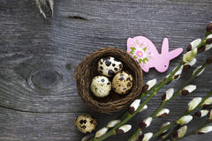 Easter eggs and willow branches on wooden desk. Easter background. stock photos