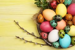 Easter eggs and willows. Easter eggs on the table Stock Photo