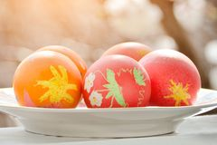 Easter eggs on the windowsill. Children`s drawing. sunlight.  Royalty Free Stock Image