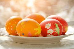 Easter eggs on the windowsill. Children`s drawing. sunlight.  Royalty Free Stock Photo