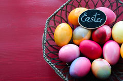 Easter Eggs in Wired Basket Stock Image
