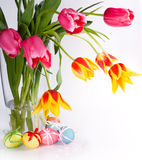 Easter Eggs With Bows And Tulips Stock Photo
