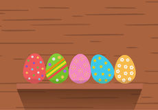 Easter eggs on wood background Royalty Free Stock Images
