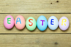 Easter eggs on wood background. Easter eggs on brown wood background Royalty Free Stock Photo