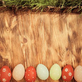Easter eggs on wood background. Spring holidays concept Stock Images