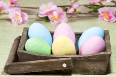 Easter eggs on a wood basket Royalty Free Stock Photo