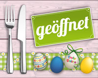 Easter Eggs Wood Checked Cloth Knife Fork Sign Open. Knife and fork with easter eggs and open sign on the wooden background stock illustration