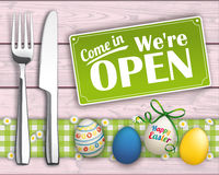 Easter Eggs Wood Checked Cloth Knife Fork Sign Open. Knife and fork with easter eggs and open sign on the wooden background Royalty Free Stock Photography