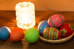 Easter eggs on the wood with lamp Royalty Free Stock Photos