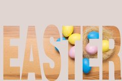 Easter eggs on wooden background. Concept stock photo