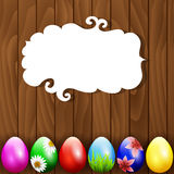 Easter. Eggs on wooden background Royalty Free Stock Photos