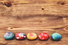 Easter eggs on wooden background. Stock Photography