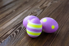 Easter eggs on wooden background. Colorful, bright stock images