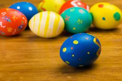 Easter eggs on wooden background, close up view royalty free stock photography