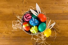 Easter eggs on wooden background, top view royalty free stock photo