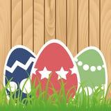 Easter eggs on wooden background. Easter eggs with grass on wooden background Stock Image