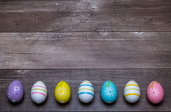 Easter eggs on a wooden background stock photography